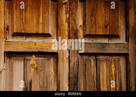 Old, weathered bare wood door, Lefkara, Cyprus October 2018 - Stock Image