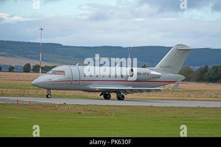 Maltese registered Canadair Challenger 605 Vistajet 9H-VFA arriving at Inverness Dalcross airport. - Stock Image