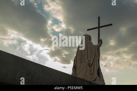 Religious Statue of the Great Mother with Cross located in front of Gran Madre Church under a Dramatic Sky, Turin ( Torino ), Italy. - Stock Image