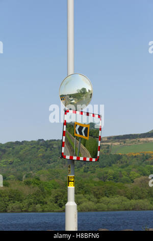 Two saftey mirrors to help drivers emerging from a concealed entrance on the inside of a bend in the road. The A673 - Stock Image