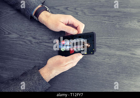Adult man using dating app on mobile phone. Matching app concept - Stock Image