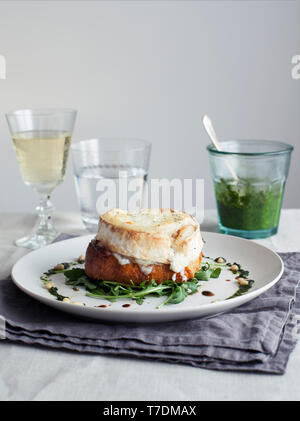Goat's Cheese Crouton with Fresh Pesto and Pine nuts - Stock Image
