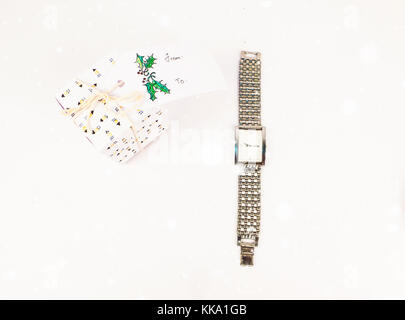 Christmas decoration with square gift boxes with men silver watch for him for celebration best Christmas holidays - Stock Image