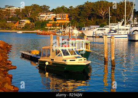Boats and foreshore homes and beach at Nelson Bay, Port Stephens, NSW, Australia - Stock Image