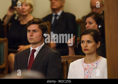RIGA, LATVIA. 8th of July 2019. Indra Levita (R), daughter of Egils Levits, Newly elected President of Latvia with her spouse (L), during Egils Levits Solemn oath and address at the extraordinary session of the Saeima (Latvian parliament). Credit: Gints Ivuskans/Alamy Live News - Stock Image