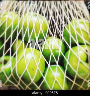 String shopping bag with green apples - Stock Image