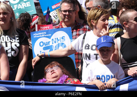 London, UK - 30 June 2018: Thousands of people take part in a national demonstration and celebration to mark the 70th anniversary of the NHS on 30 June. The demonstration organized by The People's Assembly amongst other seek for A publicly owned NHS that is free for all and proper funding and proper staffing.  Credit:  David Mbiyu Credit: David Mbiyu/Alamy Live News - Stock Image