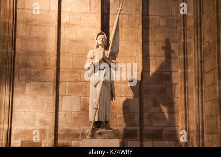 Statue of Joan of Arc (Jeanne d'Arc) inside the Cathedral of Notre Dame de Paris. Paris, France - Stock Image