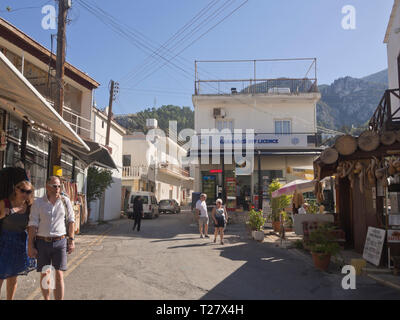 Narrow street with shops and tourists in the village of Beylerbeyi (Bellapais) in the northern part of Cyprus - Stock Image
