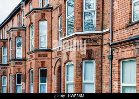 Typical Victorian three storey houses in Belfast. - Stock Image