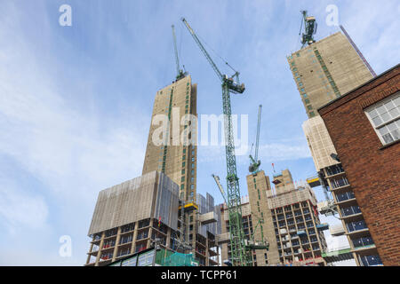Cores of the new high rise mixed use Victoria Square retail commercial real estate development under construction in Woking town centre, Surrey, UK - Stock Image