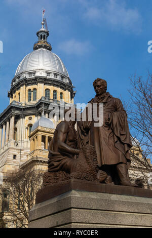 Statue with State Capitol Building in the background.  Springfield, Illinois, USA. - Stock Image
