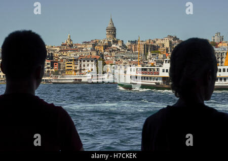 Partial view of Istanbul across the Golden Horn.  Galata Tower can be seen dominating the skyline at the top centre - Stock Image