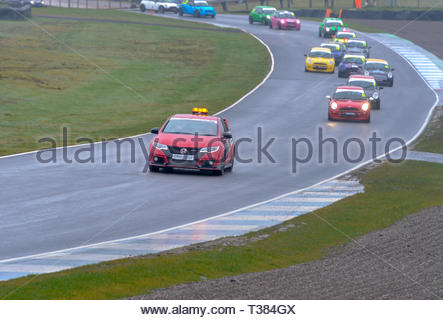 Dunfermline, Scotland, UK. 7th April, 2019.  Safety Car leads competitors after an accident during a Celtic Speed Mini Cooper Cup race at Knockhill Circuit. During a wet and misty opening round of the Scottish Championship Car Racing season organised by the SMRC (Scottish Motor Racing Club) at Knockhill. Credit: Roger Gaisford/Alamy Live News - Stock Image