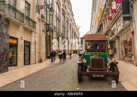 LISBON / PORTUGAL - FEBRUARY 17 2018: VINTAGE GREEN CAR IN LISBON - Stock Image