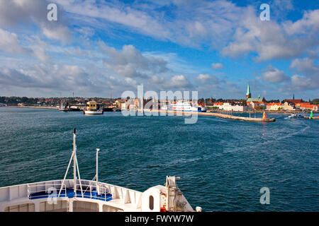 A ferry is approaching the entrance to the harbor in Helsingør seen from a boat crossing Øresund. - Stock Image