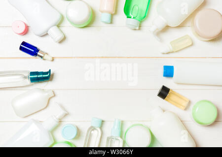 Frame of plastic bodycare bottle Flat lay composition with cosmetic products on wooden background empty space for you design. Set of White Cosmetic co - Stock Image