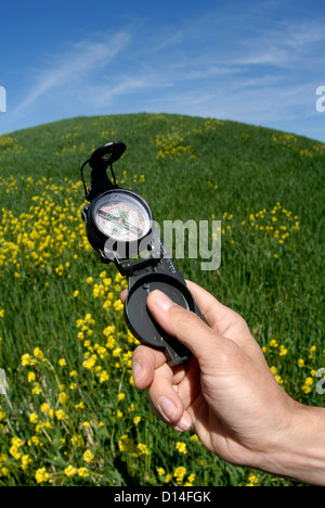Man's hand holding compass - Stock Image