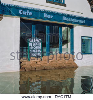 Restaurant protected with sandbags from floods - Stock Image
