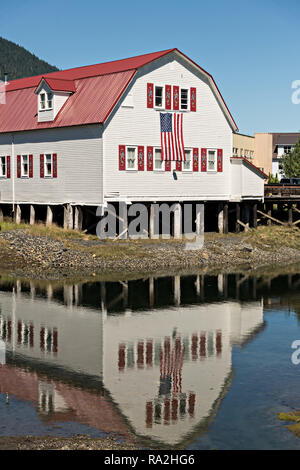 The Sons of Norway Hall Fedrelandet Lodge reflected on Hammer Slough in Petersburg, Mitkof Island, Alaska. Petersburg settled by Norwegian immigrant Peter Buschmann is known as Little Norway due to the high percentage of people of Scandinavian origin. - Stock Image