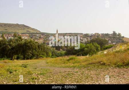 An Islamic mosque with it's towering minaret in the small village of Migdal in Northern Israel - Stock Image