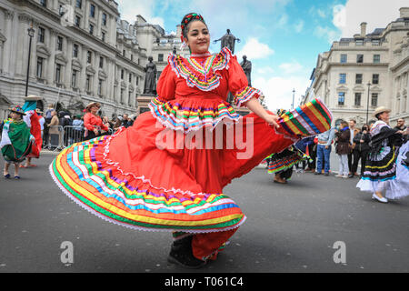 London, UK, 17th Mar 2019. Colourful South American Dancers from various countries brighten up the parade. Now in its 17th year, the parade attracts more than 50,000 people for a colourful procession of Irish marching bands from the UK, US and Ireland, energetic dance troupes and spectacular pageantry. Credit: Imageplotter/Alamy Live News - Stock Image
