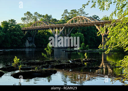 Bibb Graves bridge over the Coosa River in Wetumpka, Alabama, USA, from a low angle. - Stock Image