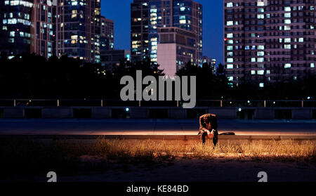 Lifestyle of businessman tired and gloomy in city at night - Stock Image
