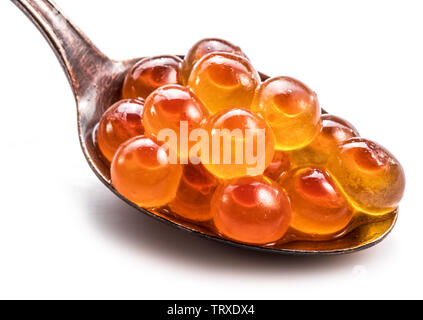 Silver spoon of red caviar on white background. Macro picture. - Stock Image