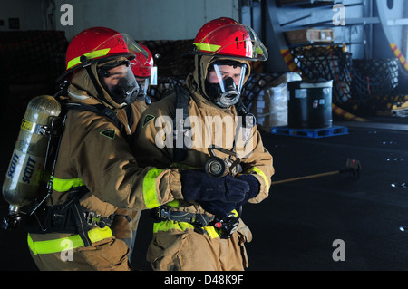 Sailors train for a mass casualty event. - Stock Image