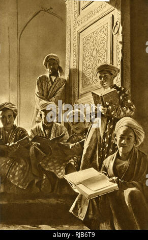A group of mullahs with their books, wearing patterned vestments in the panelled lecture room of a mosque in Bukhara, Uzbekistan, Central Asia. - Stock Image