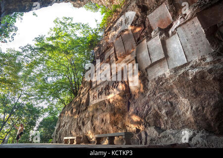 Stone inscriptions at Wooden Dragon Cave on Diecai Hill, Guilin, China - Stock Image