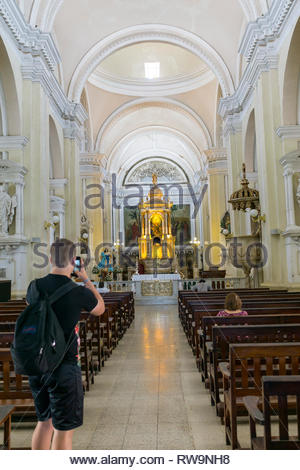 Tourist takes a photo of the nave of the Cathedral of the Assumption of Mary in Leon, Nicaragua - Stock Image
