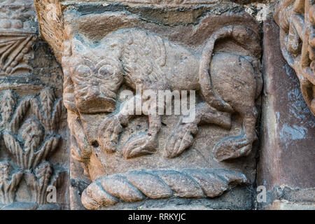 Leominster Priory, UK. The 12c west doorway has elaborate capitals by the Herefordshire School of sculptors. A lion - Stock Image