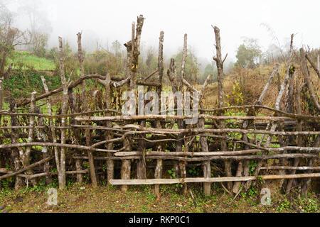 Wooden fence in the village of Pothana, Annapurna region, Nepal. - Stock Image