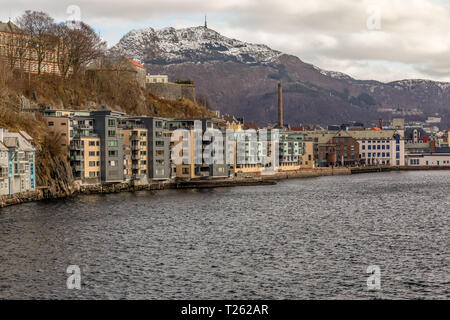 The Port city of Bergen in Norway, showing the entrance to the port and harbour, and buildings alongside. - Stock Image