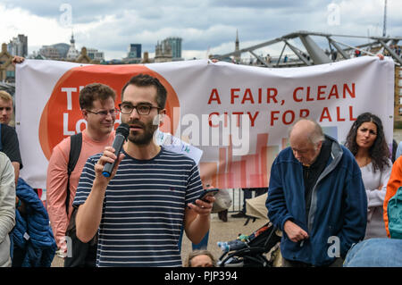 London, UK. 8th September 2018. James speaks about the new 'The London Leap' campaign at the Climate Reality rally in front of Tate Modern, one of thousands around the world demanding urgent action by government leaders to leaders commit to a fossil free world that works for all of us.  community leaders, organisers, scie Credit: Peter Marshall/Alamy Live News - Stock Image
