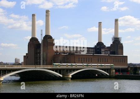 Grosvenor Bridge or Victoria Railway Bridge, and Battersea Power Station, London, UK. View from Chelsea Bridge. - Stock Image