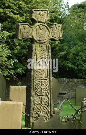 Cross on tombstone in Eyam graveyard, Derbyshire - Stock Image