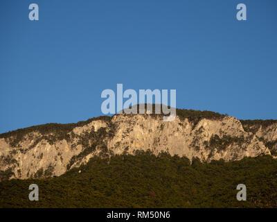 Mountain range and blue sky - Stock Image