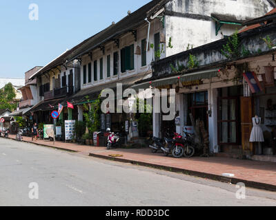 Looking along Main street ancient Luang Prabang town Laos Asia  royal capital of country until 1975  designated a UNESCO World Heritage Site in 1995 - Stock Image