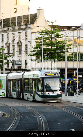 A city tram in the centre of Nottingham, UK. - Stock Image