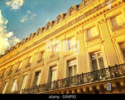Beautiful old apartment building with classical architecture along Les Grands Boulevards in Paris, France. Vintage - Stock Image