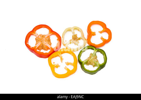 Mixed pieces of different colored paprikas isolated on white, olympic circles - Stock Image