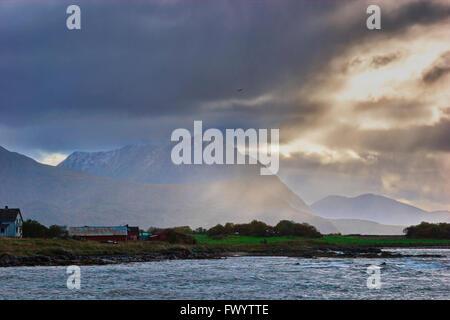Rain showers are lashing the coast near Borkenes on island Hinnøya in northern Norway. - Stock Image