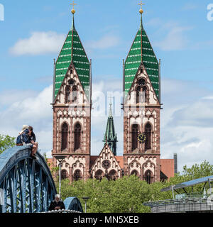 Bridge Wiwilíbrücke, Wiwilíbridge, blue bridge, Stühlingerbridge, with Herz-Jesu church, Freiburg, Breisgau, Baden-Würtemberg, Germany - Stock Image