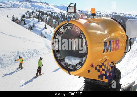 Snowgun at a ski piste of the mountain Paganella, Trentino, Italy - Stock Image