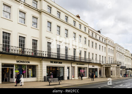 Shops in Regency period buildings in town centre with people shopping. The Parade, Royal Leamington Spa, Warwickshire, West Midlands, England, UK - Stock Image