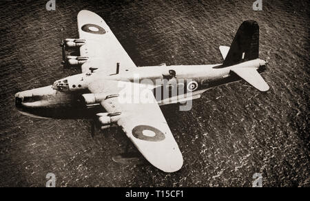 Developed and constructed by Short Brothers for the Royal Air Force, a Short Sunderland S25 flying boat patrol bomber, on patrol over a British convoy.  At 85 feet long, it was the most luxurious wartime aircraft with a WC, wash basin, cooker and kitchen sink, with a crew of twelve who are often airborne for 14 hours they need those facilities. The German U-boat crews called it the  'Flying Porcupine' because it was so effective at clearing the decks of Jerry submarines. Sunderlands damaged or sank  43 German U-boats and 12 from the Italian navy, for the loss of just ten Sunderlands. - Stock Image
