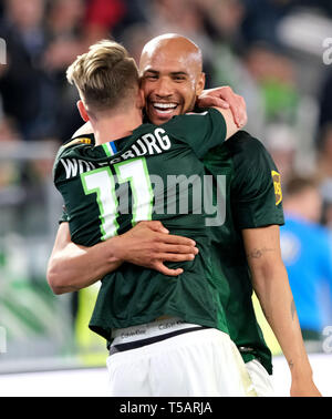 22 April 2019, Lower Saxony, Wolfsburg: Soccer: Bundesliga, 30th matchday: VfL Wolfsburg - Eintracht Frankfurt in the Volkswagen Arena. Wolfsburg's John Anthony Brooks (r) cheers his goal to 1:1 against Eintracht Frankfurt with Felix Klaus. Photo: Peter Steffen/dpa - IMPORTANT NOTE: In accordance with the requirements of the DFL Deutsche Fußball Liga or the DFB Deutscher Fußball-Bund, it is prohibited to use or have used photographs taken in the stadium and/or the match in the form of sequence images and/or video-like photo sequences. - Stock Image